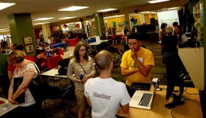 "A ""hacker"" speaks with members of the community at a Tulsa, Oklahoma event for the National Day of Civic Hacking."