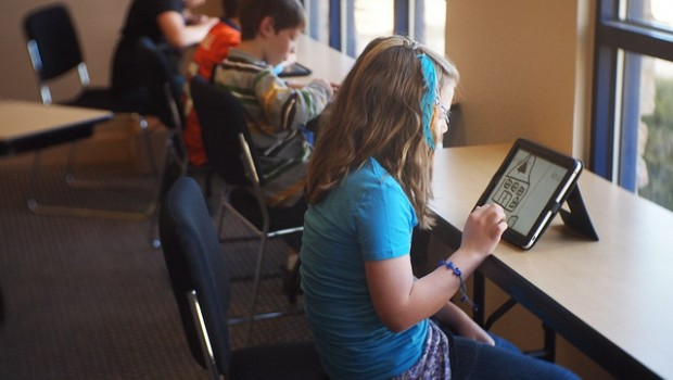 Students using iPads, which are capable of collecting valuable data.