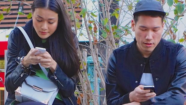 A couple on their phones.