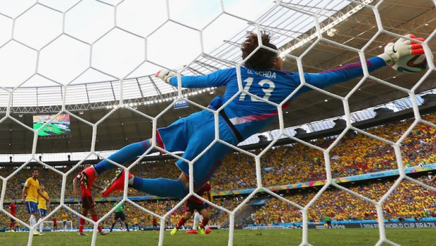 Mexico's Guillermo Ochoa blocks a shot from Brazil's Neymar in the 2014 FIFA World Cup. This save marked the first instance during the cup when referees turned to a goal-line monitoring system to confirm the save.