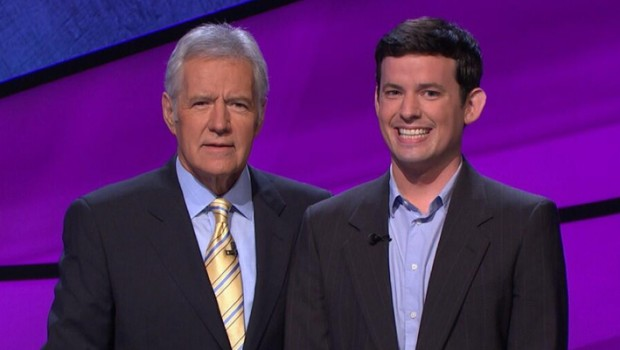 Jeopardy host Alex Trebek poses with a winner.