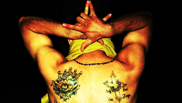 Tattoos of a Latin Kings gang member