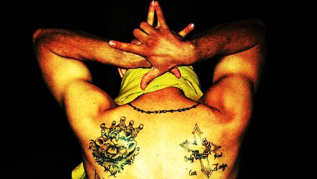 Tattoos of a Latin Kings gang member
