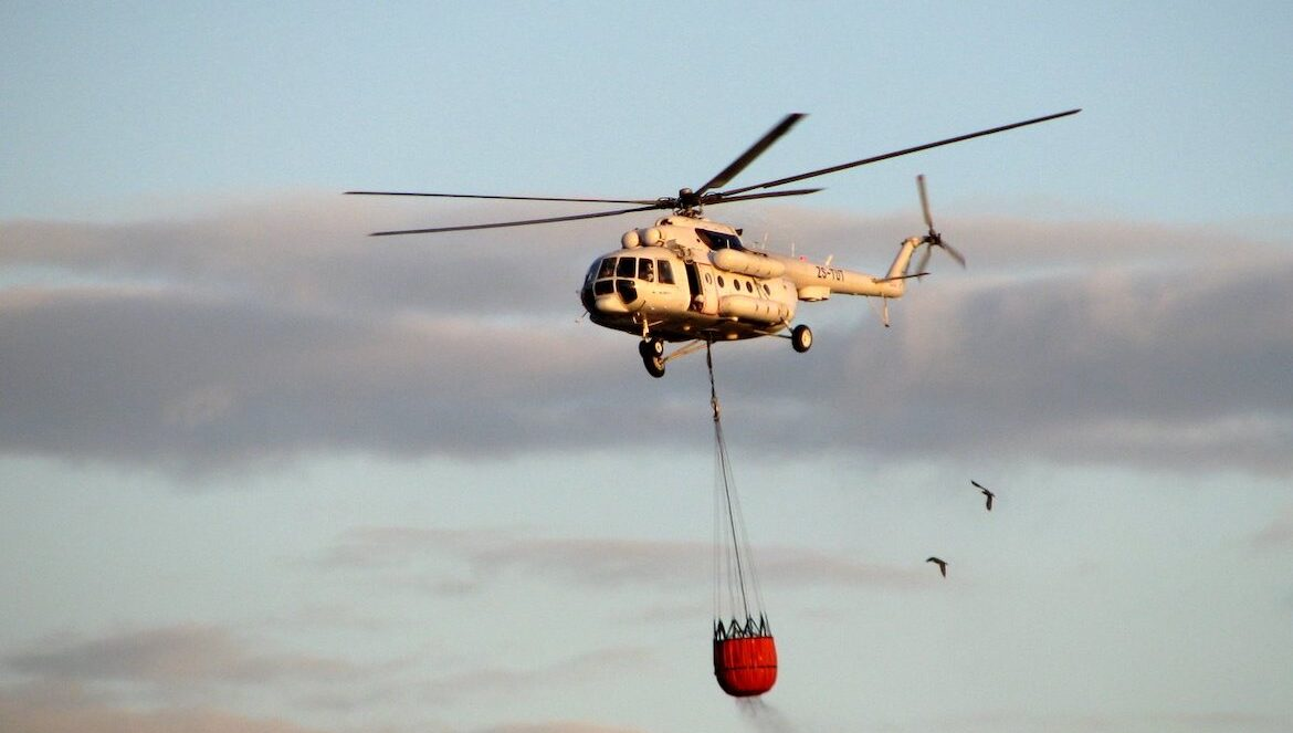 Helicopter carrying water to a fire